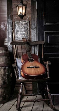 Old Guitar On Chair Android Wallpaper