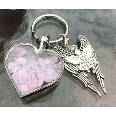 Rose Quartz Wishing Bottle,Pretty Wings, Angels Watching Over Me Charm... ($12) ❤ liked on Polyvore featuring jewelry, pendants, heart-shaped jewelry, rose quartz crystal jewelry, crystal charms, rose quartz jewelry and wing charms