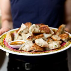 Mama Chang's Pork and Chive Dumplings with Black Pepper-Scallion Sauce | Chef Joanne Chang and Karen Akunowicz's Pork and Chive Dumplings with Black Pepper Scallion Sauce are the perfect weeknight dinner or party treat. Get the recipe at Food & Wine.