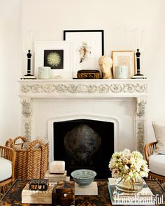The living room mantel and coffee table display a few of his passions: boxes, books, and art from China and Paris flea markets. Amy Neunsinger  - HouseBeautiful.com