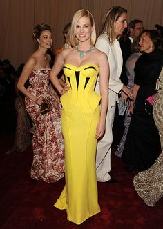 Emma Frost in yellow Versace dress at Met Gala
