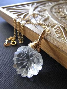 AAA carved rock crystal and goldfill necklace. Love crystal & gold