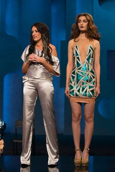 Designer Kelly with one of her final looks from Season 14 of Project Runway.