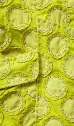 Fabric manipulation and textile design - embroidering with appliqué and feather stitch