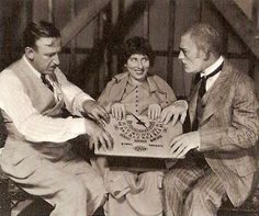 Tod Browning, Polly Moran and Lon Chaney here pretending to commune with the spirit world for the MGM publicity department , circa 1927