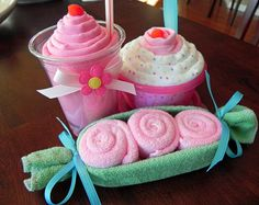 Sundae Ingredients:    1 Receiving Blanket   1 Baby Onesie (size 0-3 months)  1 Take & Toss Bowl and LId  1 Take & Toss Spoon  Cellophane Bag & Coordinating Ribbon    Milkshake Ingredients:    1 Receiving Blanket   Milkshake Cup & Straw  Cellophane Bag & Coordinating Ribbon    Peapod Ingredients:    4 Infant Washcloths  Cellophane Bag & Coordinating Ribbon