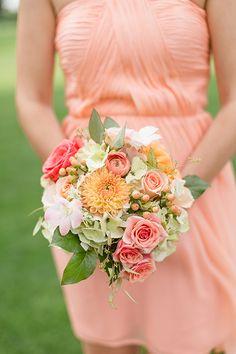A bridesmaid bouquet with dahlias and roses | @chelsperphoto | Brides.com