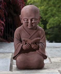 Alfresco Home Reading Buddha Garden Statue | Add a unique touch of décor to the garden with this Buddha statue. Crafted from durable polyresin and stone, this whimsical piece will provide the perfect flourish to any outdoor area!