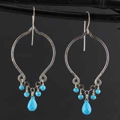 Silver Turquoise Stone Earrings. Turquoise Dangle & Drop Sterling Silver Earrings. Silver Turquoise Earrings Handmade ©TGG Turquoise Jewelry Metal - Sterling Silver Gemstones - Turquoise (Faceted & Matte Finish) Length - 2.25 Long (measured below ear wire) Style - Chandelier Dangle Finish - Hammered ………………………………………………. SHIPPING Your jewelry will come ready for gift giving in a cotton filled craft gift box tied with ribbon. Jewelry is shipped upon cleared payment (3-5 Business Days)...