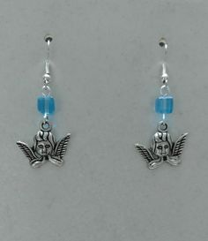 """Light blue glass cube beads  Tibetan silver metal cherub charms  Silver plated nickel free french wires  2"""" long 