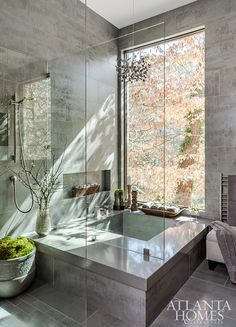 A Japanese soaking tub, custom made by builder Chris Donnelly of Brookside Custom Homes, serves as the focal point of the bathroom. Custom Leather Sofa, Beautiful Bathrooms, Wall Mount Faucet, Bathroom Inspiration, Sparkle Tiles, Homeowner, Custom Homes, Kohler Tub, Japanese Soaking Tubs