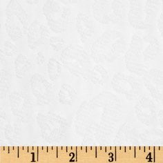 Pique Knit Jacquard Cheetah White from @fabricdotcom  This pique knit fabric is perfect for tops, T-shirts and layering apparel. It features a semi-sheer jacquard design over a pique knit. It has 25% stretch across the grain.