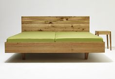 Contemporary style wooden double bed, design by Laszlo Szikszai (2014)