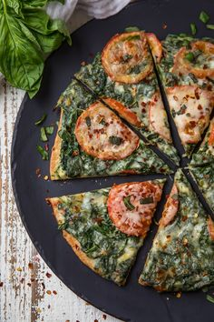Skinny Garlic Spinach White Pizza has everything you could ever want or enjoy in a pizza, without all the stuff your body doesn't love!
