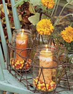 Old milk bottle wire carrier repurposed for a beautiful centerpiece that can be changed for the seasons