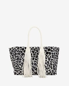 Sara Battaglia Fringe Safari Print Calfhair Shopper Tote: A safari inspired printed calfhair has wild about you written all over this shopper tote. Magnetic closure. Internal pockets. Measures: Width 55.5cm/Depth 18cm/Height 27.7cm with double 19cm handles. Fully lined in signature Green satin. In cream. ...