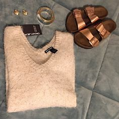 DKNY Jeans Fuzzy Sweater NWT L This DKNY Jeans sweater will keep you warm (and cute) on cold days. It's fuzzy! Size L. Will look nice with black leggings. Cream colored with gold shimmer throughout. 72% Acrylic 24% Nylon 4% other fibers DKNY Sweaters