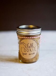 DIY Sugar Cookie Foot Scrub Ingredients  2/3 cup granulated white sugar 1/3 cup packed brown sugar 1/2 cup olive oil 1 tbs vanilla extract 1 half pint mason jar Baker's twine Label (with a sticker back) Fine point black marker