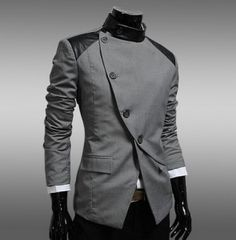 Asymmetrical Button Blazer. Would look great along with a shaved head.