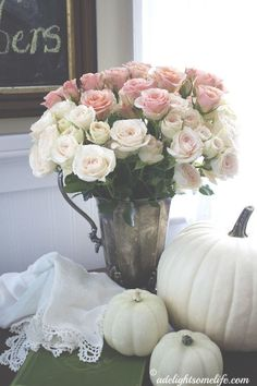 I love this romantic look...pink roses and white pumpkins. The softer side of Autumn adelightsomelife.com