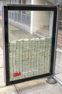 3M Security Glass Advertising - Yes, it's real money.  Unique and way to see it in person.