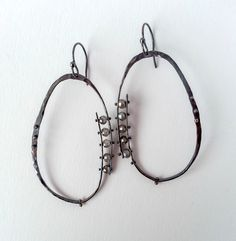 Hand Forged Riveted Sterling Silver Hoop Earrings With Labradorites by SmallJoysStudio on Etsy https://www.etsy.com/listing/224247347/hand-forged-riveted-sterling-silver-hoop
