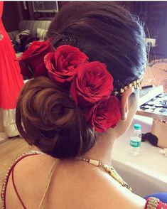 Brown hair, low bun and red roses Bridal Hairstyle Indian Wedding, Bridal Hair Buns, Bridal Hairdo, Indian Wedding Hairstyles, Bride Hairstyles, Hairstyles Haircuts, Mexican Hairstyles, My Hairstyle, Turbans