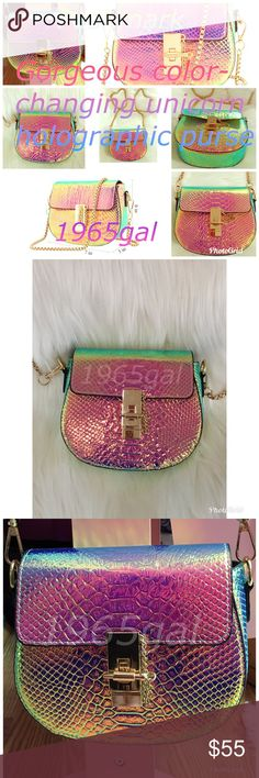 Gorgeous color-changing unicorn holographic purse NWOT This is the most gorgeous purse! It is so reflective & the rainbows of shifting colors are almost too much for the eyes to take in! It's whimsical magical & beautiful! You will get so many compliments! Order today and I can ship it to you quickly! It has a beautiful gold chain handle and falls to the hip area. See pictures. It will be wrapped up untouched for you when you get it as the pictures are of my personal purse thanks for…