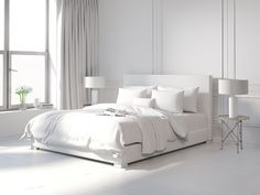Pairing the minimalist theme with a contemporary twist, a bedroom like this one is intriguing in its simplicity. There is absolutely no clutter or mess to the room with objects or accenting colors. You have a clean, white room with a few accenting pieces such as the flowers in the windowsill that are also white. Having less is more when it comes to the theme of this room.