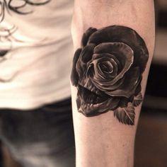 skull hidden in black rose tattoo