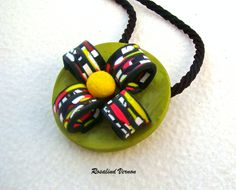 Stropple cane, and bright spring colours. make this polymer pendant