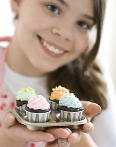 Cupcakes baked in ketchup cups, so cute for a party or a shower! You can use a flat baking sheet too as the cups are strong enough and don't need a muffin tin.