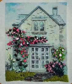 It's embroidery but I like the idea for a painted rock house, especially the flowers