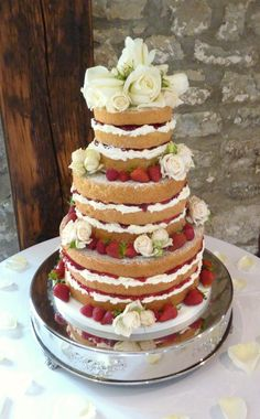 Naked Wedding Cake with Fresh Roses and Strawberries.