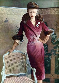 Sophie is wearing exquisite faded rose velvet coatdress trimmed in mink by Jacques Fath, veiled mink hat, jeweled clips by Roger Scemama, 1950