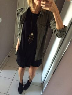Layer an olive green utility shirt over a simple black dress and top it off with ankle booties and a statement necklace | Fall outfit inspiration | Fashion