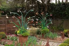 Yard art...rebar, garden hose and vintage sprinklers  by Freeland + Sabrina Tanner