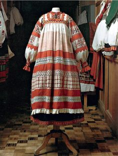 A Russian folk costume: note it is a jumper/overdress over the embroidered blouse.....