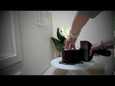Learn how to layer and ganache your cakes using the 2 card technique to ensure a smooth sharp finish - perfect base for covering with fondant    Happy Caking!!!!    Please remember that this method is what works for me and may not suit everyones style.....    x    The app used in this tutorial can be found here   http://itunes.apple.com/nz/app/ihandy-lev...