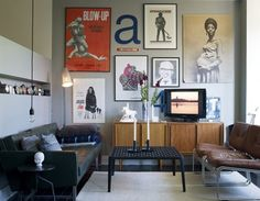 Vintage brown leather chairs, eclectic artwork