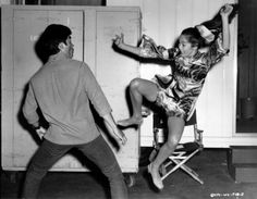 * m. Nancy Kwan, having a go at Bruce Lee on set for Dean martin's The Wrecking Crew