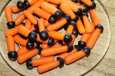 nerf party food....these were a big hit...baby carrots with olives! these look amazing