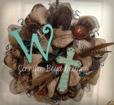 Turquoise and brown cross personalized mesh wreath by Jennifer Boyd Designs.      Find me on Facebook: www.facebook.com/JenniferBoydDesigns