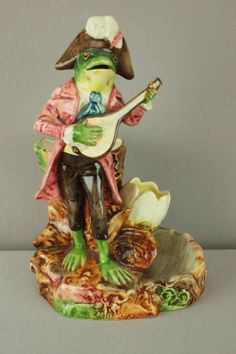 Continental majolica figural match striker with standing frog playing mandolin