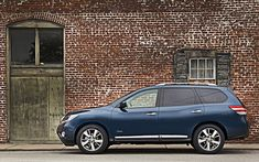 """Known as the perfect family adventure vehicle, the 2014 Nissan Pathfinder Hybrid blends """"green"""" technology with comfortable seating for seven and 3,500-pound towing capacity."""