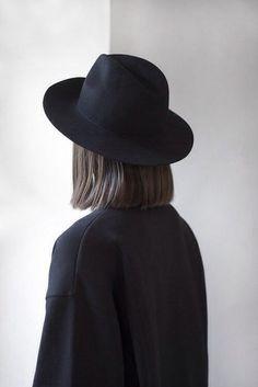 black hat, fedora, short bob, minimalist style, minimal hair