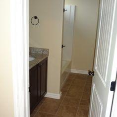 Guest bathroom, single sink, tile floor, granite