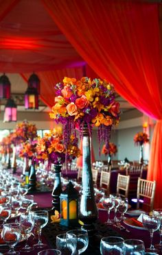 Wedding, orange, purple, black, red - kind of Morrocan theme.  Lanterns give nice touch.