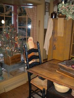 A primitive Christmas.I like the simple tree. Primitive Christmas Decorating, Prim Christmas, Christmas Kitchen, Antique Christmas, Country Christmas, Simple Christmas, Christmas Holidays, Christmas Decorations, Prim Decor