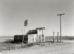 """Last Chance Texaco: October 1937. """"Abandoned garage on Highway No. 2. Western North Dakota."""" Medium format safety negative by Russell Lee for the FSA."""